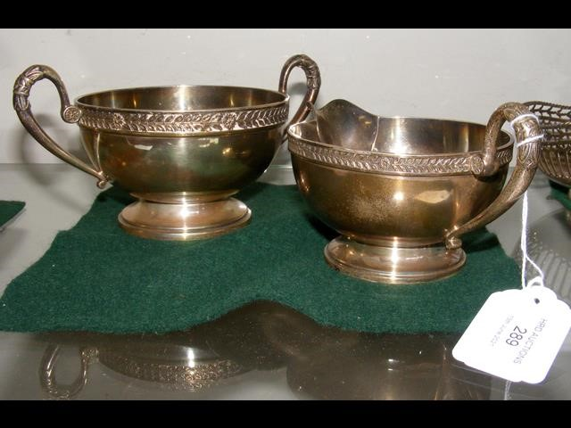 A two handled silver sugar bowl together with the