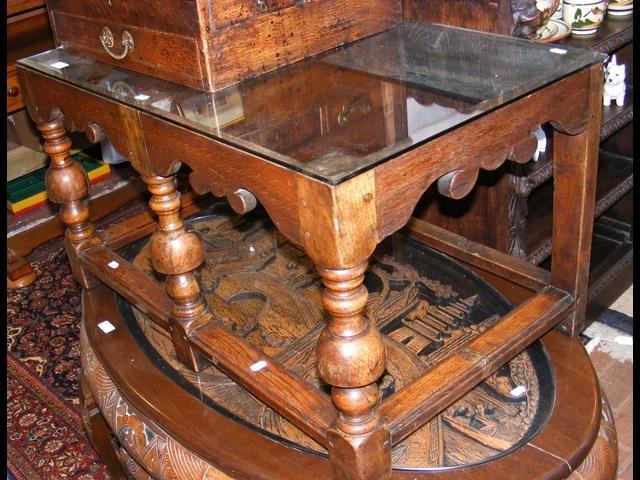 A glass top oak coffee table - width 88cm