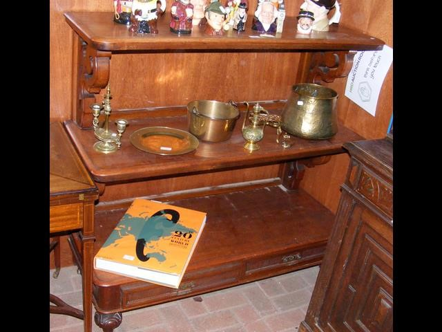 A Victorian mahogany three tier buffet with two dr