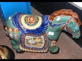 A 46cm high glazed pottery garden horse ornament