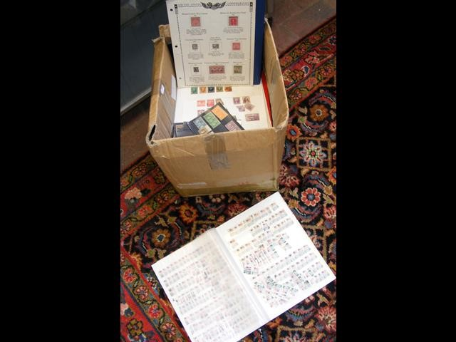 A box of albums and loose pages - US stamps