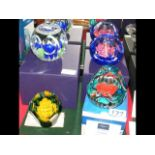 Three boxed Caithness paperweights including 'Fire