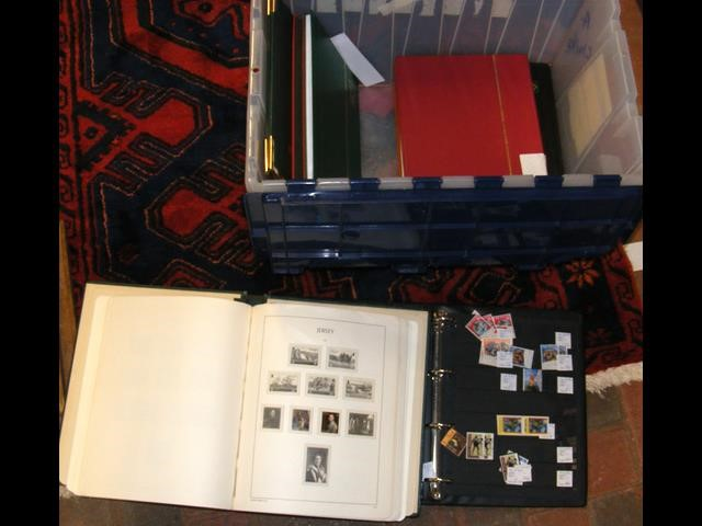 A box of albums containing GB, Channel Island and