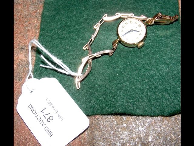 A ladies vintage 9ct gold cased Rolex wrist watch and