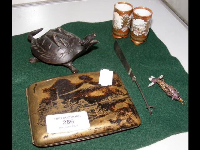 An Oriental cigarette case together with other col
