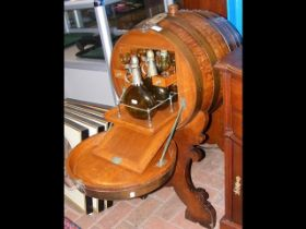 An unusual continental drinks cabinet in the form