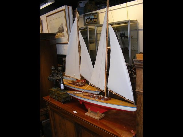 A pair of German pond yachts on stand