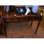 A Victorian plum mahogany desk with two drawers to the