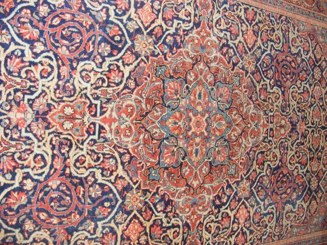 An antique Middle Eastern carpet with geometric bo - Image 4 of 4