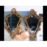 A pair of decorative metal hall mirrors - 64cm lon