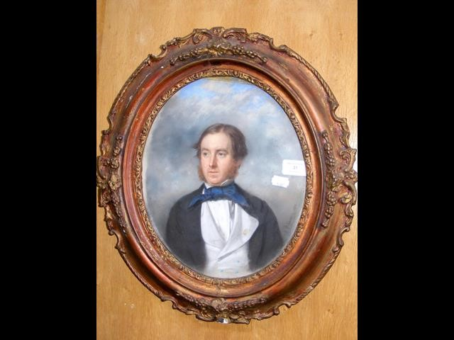 An oval portrait of gentleman - signed and dated 1