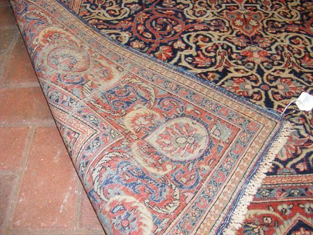 An antique Middle Eastern carpet with geometric bo - Image 3 of 4