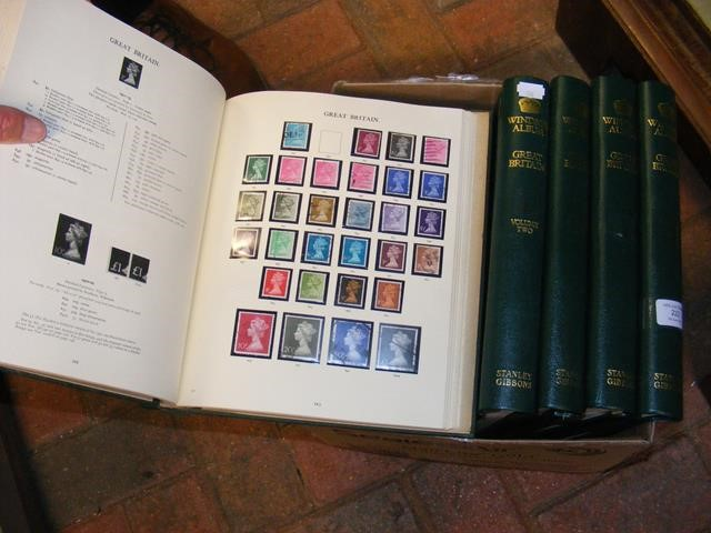 Stanley Gibbons stamp albums volumes 1-5 bearing a