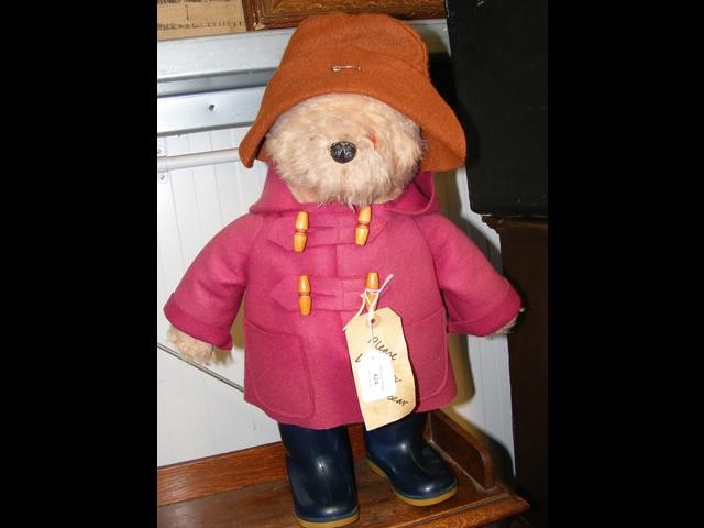 A 45cm high Paddington Bear in red overcoat