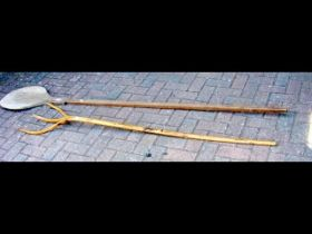 An old hay fork, together with a long handled grai