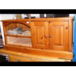 A varnished pine media unit - width 118cm