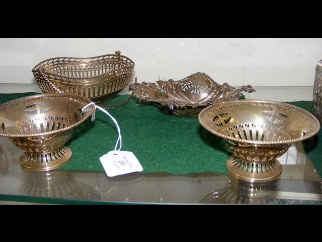 A pierced silver basket together with a pair of bo