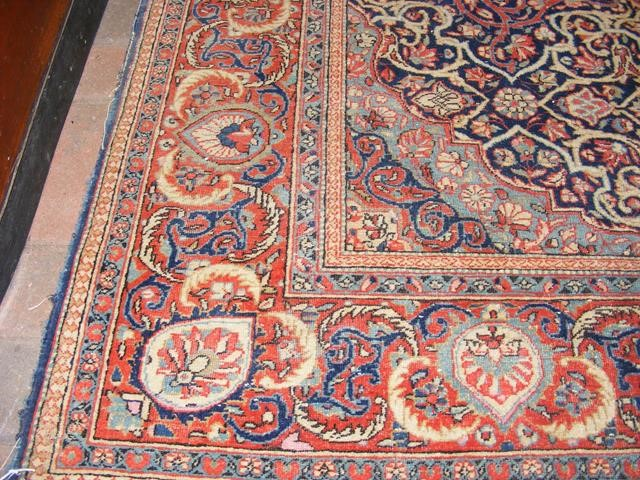 An antique Middle Eastern carpet with geometric bo - Image 2 of 4