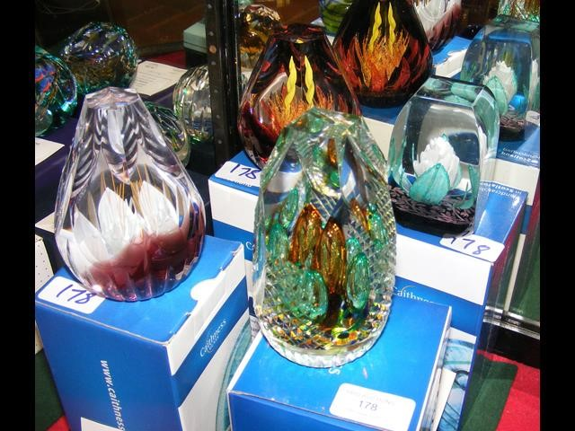 Four boxed Caithness paperweights including 'Emera