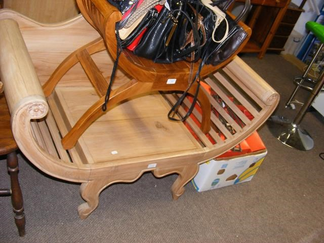 A cradle bench together with smaller cradle seat