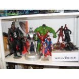 A collection of Marvel and DC comic book figures a