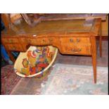 A yew wood knee hole desk - width 136cm