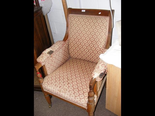 A 19th century armchair with reeded legs on casto