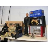 A boxed Elite Force fully poseable Navy Seal, in a