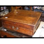 An antique writing slope with drawers to three sid