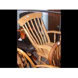 A slat back rocking chair