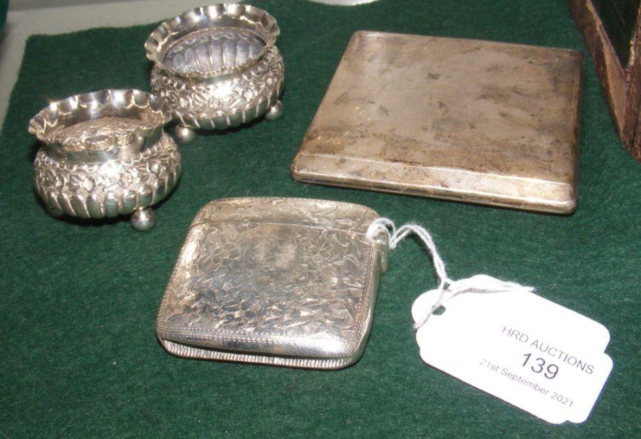 A silver vesta case, a silver cigarette case and t