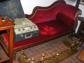 A Victorian chaise lounge upholstered in red velou