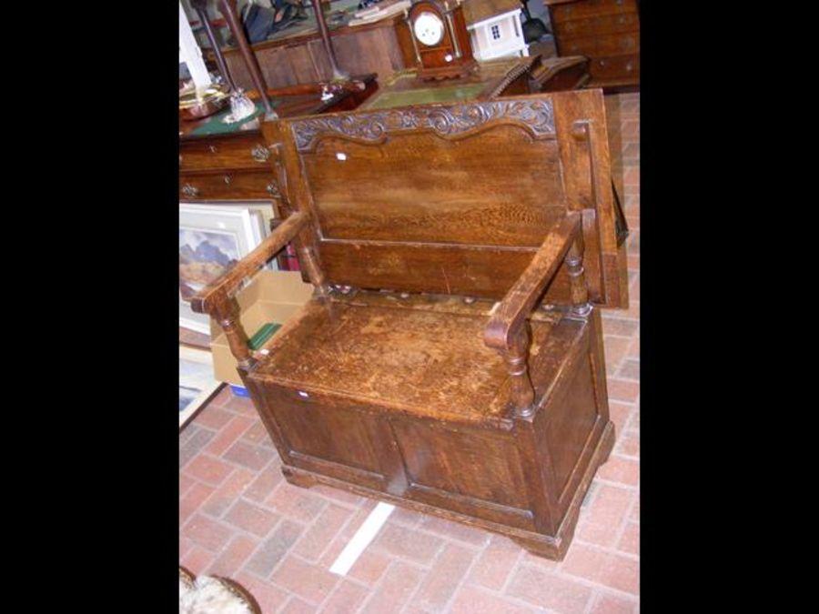A 1930's oak monk's bench