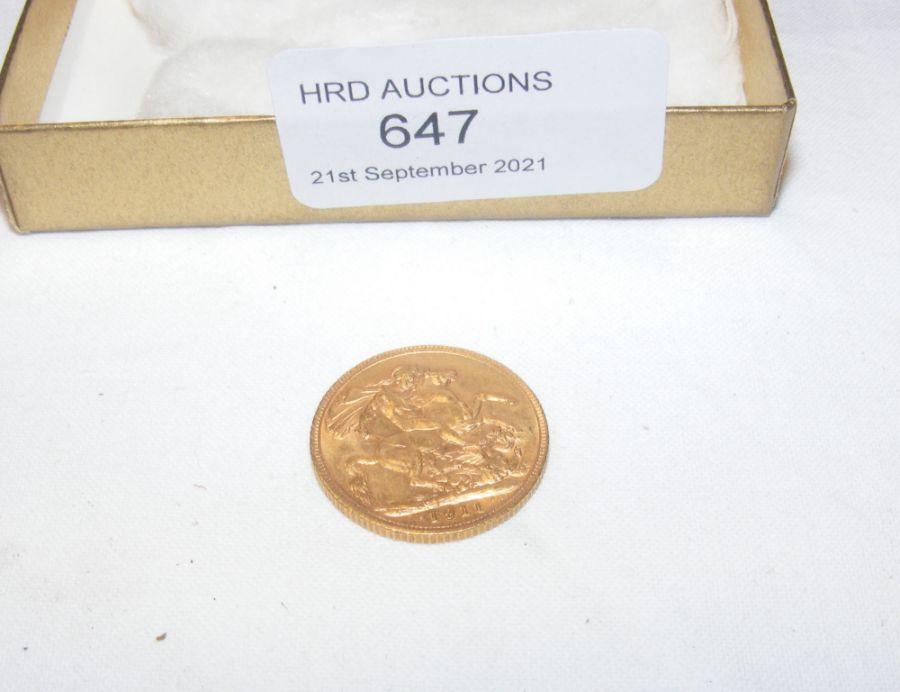 A 1911 gold sovereign coin