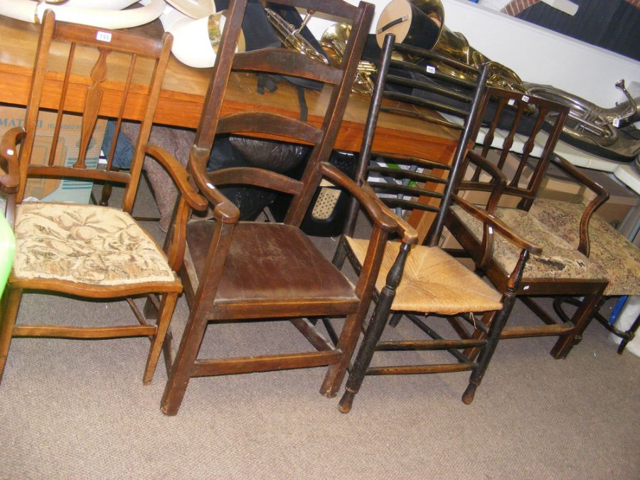 Four old wooden armchairs together with a footstoo