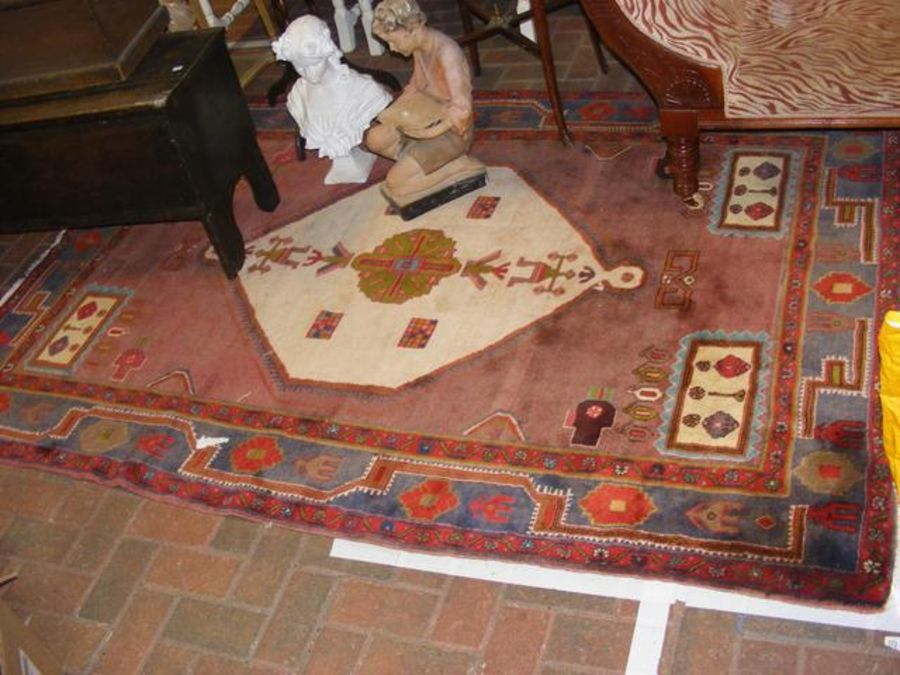 A Middle Eastern rug with geometric border and cen - Image 2 of 2