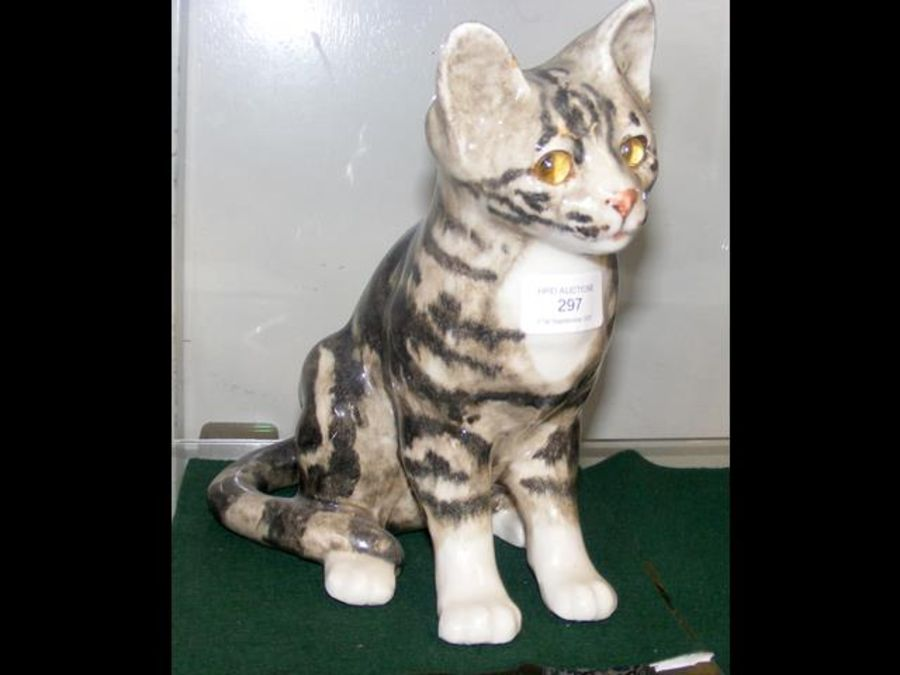 A Winstanley cat ornament with glass eyes - 24cm h