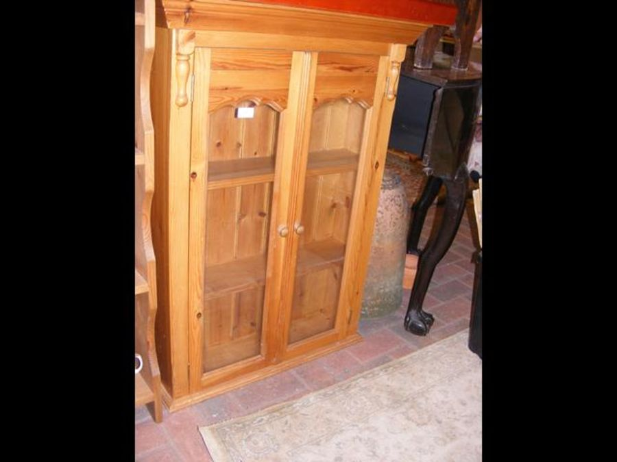 A pine display cabinet with glazed doors - width 7