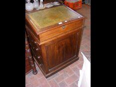 A 19th century oak Davenport desk with sliding top