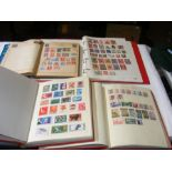 Four albums of collectable stamps including Ceylon