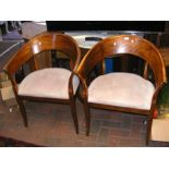 A pair of curved back tub chairs