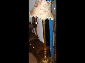 A gilt reeded standard lamp