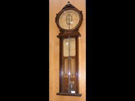 A Royal Polytechnic barometer in oak case