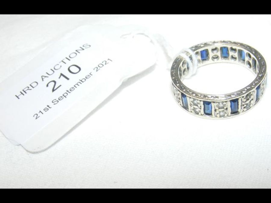 A diamond and sapphire eternity ring - Image 2 of 2