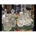 A Stuart cut glass vase together with five decante