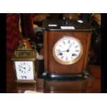 A wooden mantel clock together with a carriage clo
