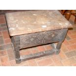 An old oak stool with hinged lid