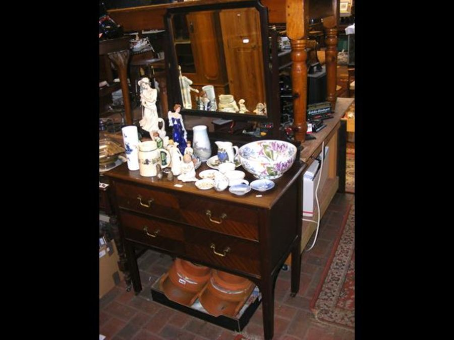 A late Victorian walnut dressing chest with bevell