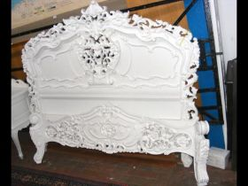 An antique French style white bedstead