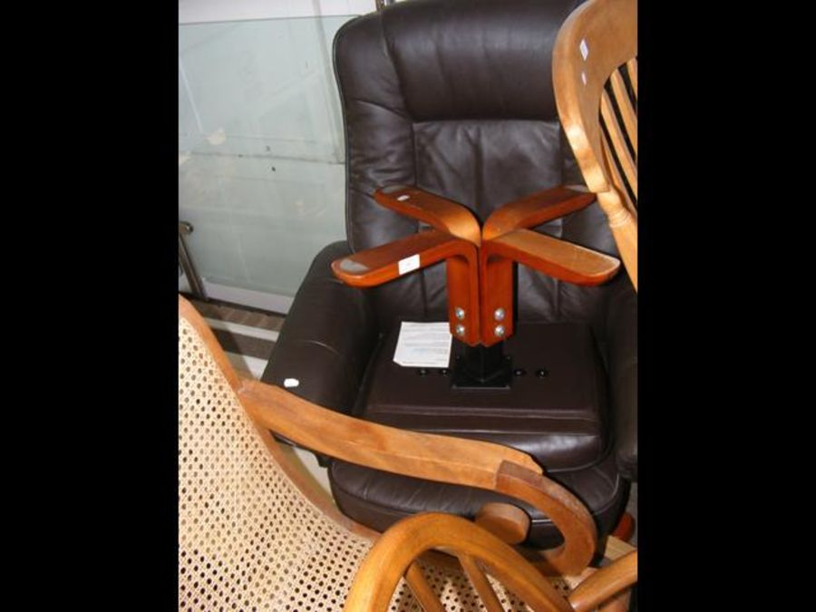 A swivel chair with footstool